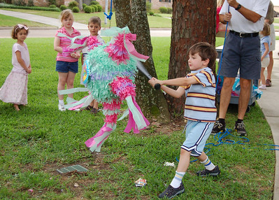 Patrick swings at the Easter Pinata