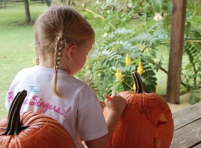 CC draws on a pumpkin