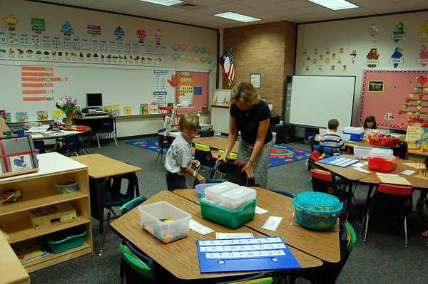Mrs. Lane welcomes Patrick to class and gives him his first assignment.