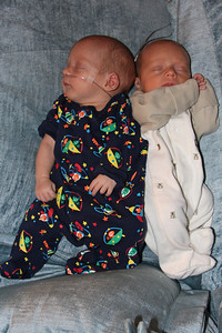 April 22nd, Adam and Ben are one month old today!  Here they are snoozing on the couch together.