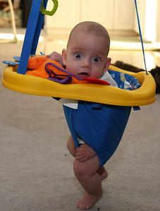 Benny checking out the bouncing chair for the first time.