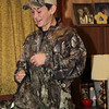 Blake with camouflage (had to look it up) jacket with leaves loosely attached.