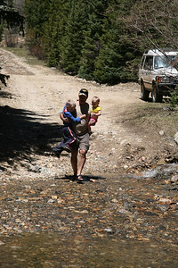 Carrying the rug rats across the stream.