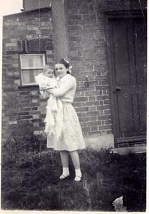 Kay-31: Kay Patterson (nee McCulloch) aged 12 Conington Cambridge with nephew Stephen McCulloch