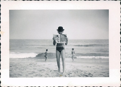Kay-32: James (Jimmy) Patterson reading Mad Magazine at Ocean Grove, New Jersey, 1950s