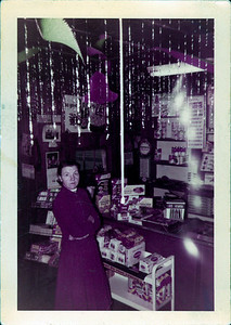 Kay-09: Annie Patterson (nee McKeown)  at the Gulf Gas Station shop, 1955