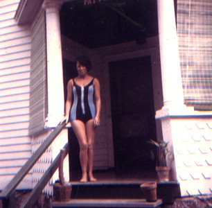 TPG - 15: Barbara Prescott Gorman on her first trip to Boonton New Jersy USA standing on the porch of 320 West Man Street