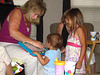 Mom shows Isabella and Savanna new toy