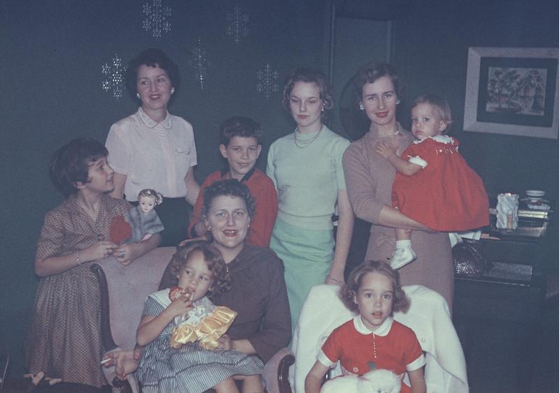 Christmas 1956. (clockwise) Kathy, Gertrude, Milton, Carolyn, Shirley, Judy, Elaine, Virginia, Diane.