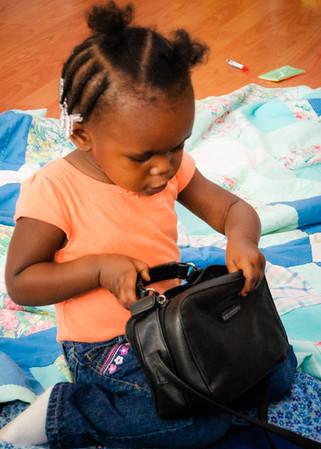 Payton explores somebody's purse