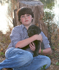Bradley and Lab pup Photo by Robin Simmons
