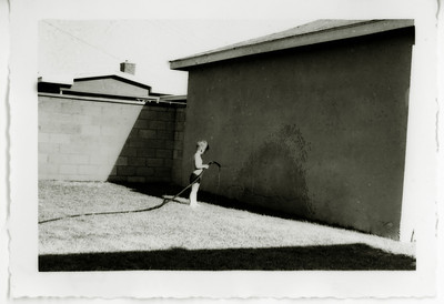 Watering the garage wall, Los Angeles, August 1952. I've always chosen to spend my spare time wisely...