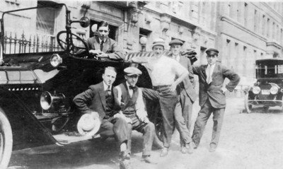 Vincent Finan (behind the wheel) with friends. ~1915-1918