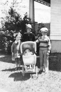 Pat, Jane, and Vincent Finan, out with the pram, ~late 1920s.
