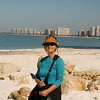 Sue on Marco Beach with the condos in the background.
