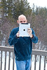 Bill photoing Mon in snow with iPad