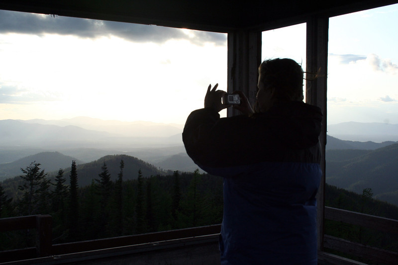 Lorinda taking a picture of the view from the tower on Spades Mt