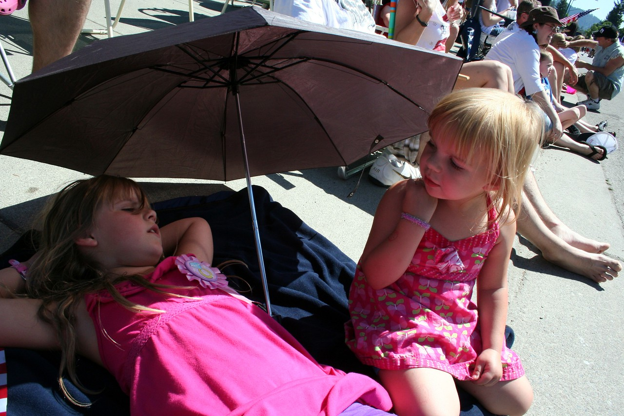 It was a very hot July 4th day.  Anissa & Makenna getting some shade.