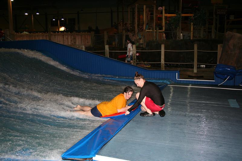 Lorinda being helped back in the wave.