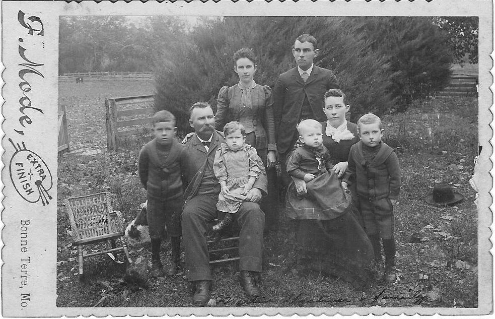 Maud Westover standing with brother Lorenzo and her father Martin with Lucy Simms and there 4 children