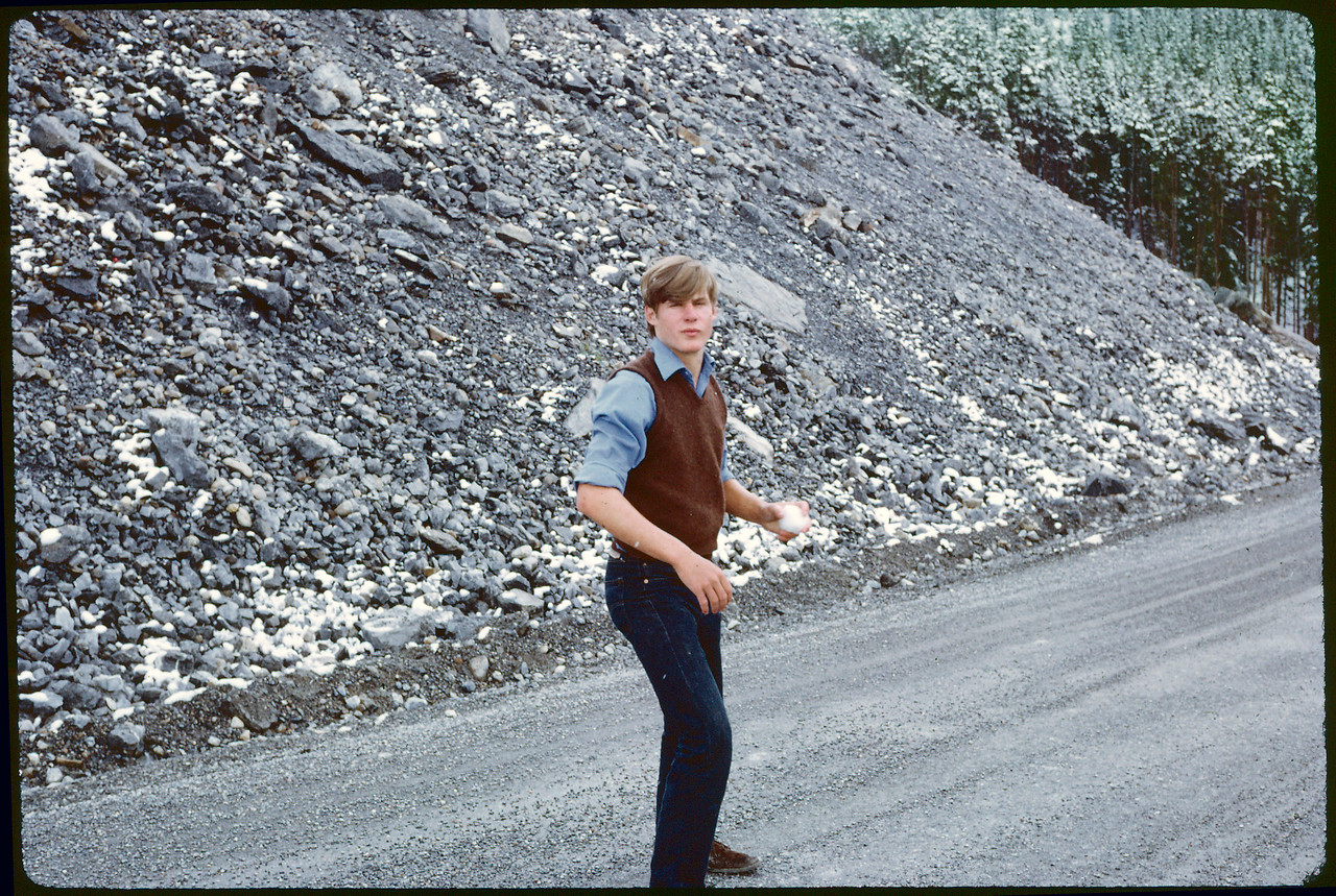 Jim about to throw a snowball on the road between Banff and Jasper in Canada. 2 July 1971.
