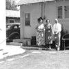 Probably Stella (Thompson) Turner with Neva and Roy Thompson at their house in Brawley, California.