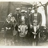 Tish family and the bus Harry built them to get to Swea City school. Front row: Lucille, Unknown, Frances. Medium row: Mary, Marion, Buddy. Back row: Marvin and Raymond.