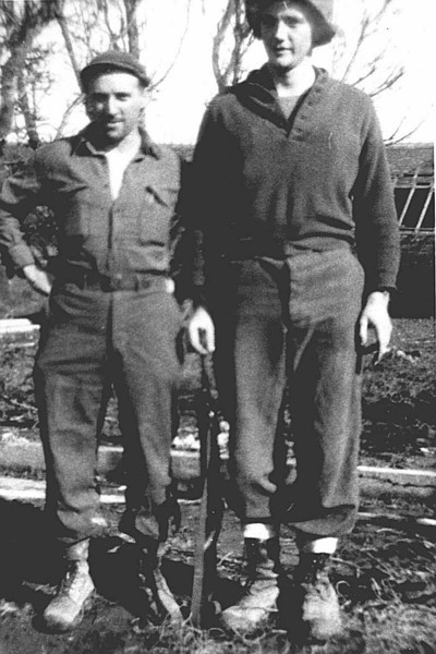 "Dad with Ed Burzycki, Heiligenbronn Farm, Enchenberg, France, winter 1945.  Caption on back: ""Burzycki & Jones, 'The Combat Kids'"".  See later photo for complete text."