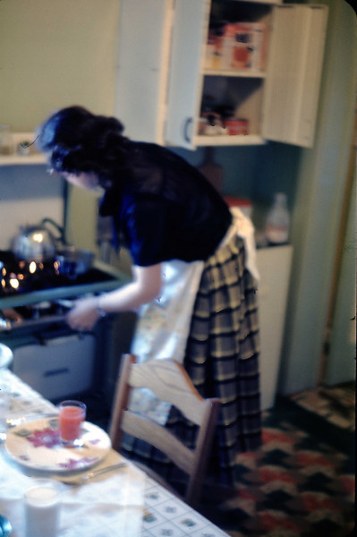 Jean in kitchen of their first apartment, upstairs at 2930 S. Washington, Saginaw, Michigan - March 1949