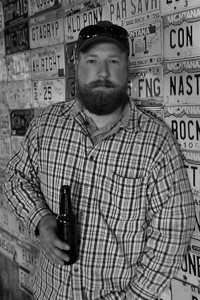 Tim drinking a beer in Red Horse, Montana. Roadtrip to Montana 2013. Kodak TMax 400