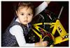 Bella repairing Mikas bicycle