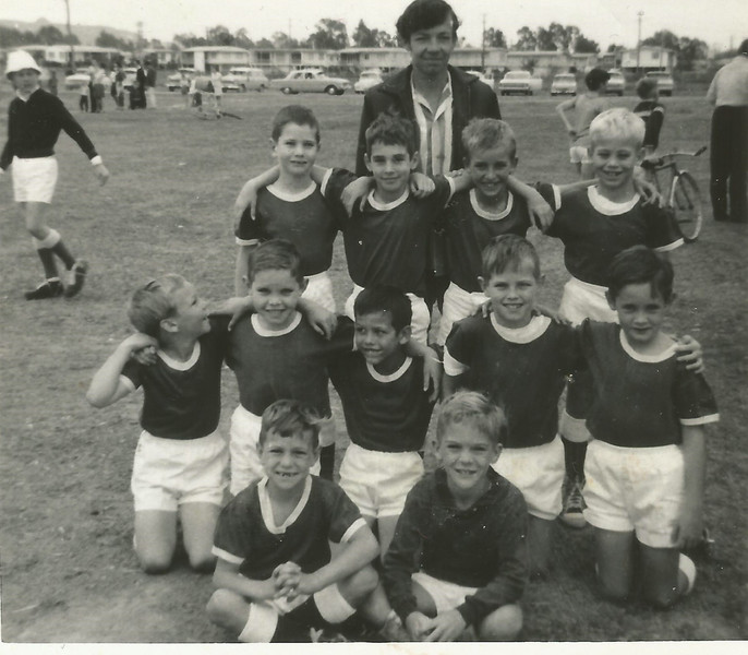 Scanned Photo, Townsville, Aitkenvale u10 soccer team, Premiers, 1969 (or 1970), Back: Coach Mr Butler, Back Row: Russell Poschalk, Ian Beck, Jodie Lagetti, ??, Middle Row: ??, Peter Savage, ??, ??, Michael Roderick, Front Row: Tony Nielson, Stephen James (Goalie)