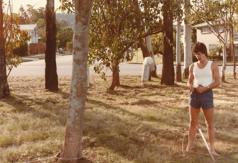 Peter Roderick, Dorrington park, Ashrove, helping with a field experiment for Michael Roderick Univ. project, 1983