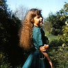This photo was taken to document my long hair JUST before I had it cut short.  I remember brushing it out (after un-braiding it), and posing in the sun.  1956?