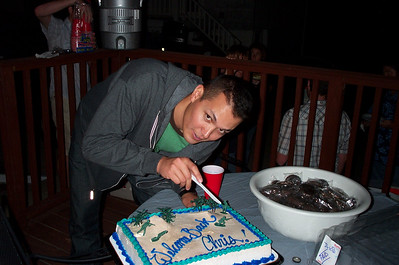 Chris cutting his welcome back cake