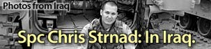 This was the tag-line featured on the website of the Lawrence Journal World website.  Chris' photos from his time in Iraq were included in the LJWorld's Iraq Photo Gallery.