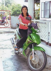My older sister Rose in the Philippines, with her new bike.