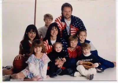 Rode Family, 1997.  Charlotte and Mike in Stars and stripes, Michael II (karate bo), Bree (basketball), CC (skating), Levi (baseball), ShaeLyn (gymnastics), Mark (soccer), Chritian (mom's lap)