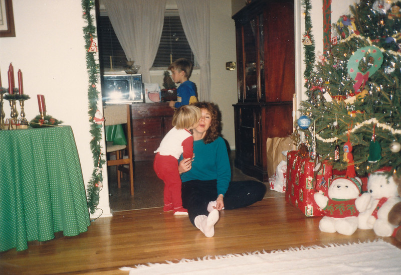 Jeff kissing Aunt Marilyn under the mistletoe