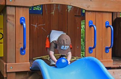 Jordan rolling balloon down the slide.