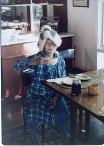 Sam Wearing a tea cozy
