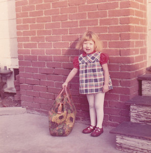 Kira with suitcase prior to going to Pittsburgh Nov 1972