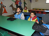 """Ian and Owen get settled into their seats in the """"Kinder Ski School""""."""