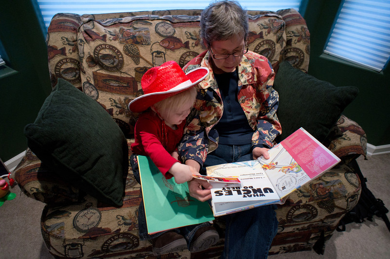 Katie reading with Grandma Laurie
