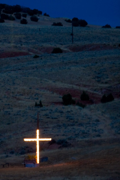 A bright cross several hundred yards from the road in the middle of nowhere.