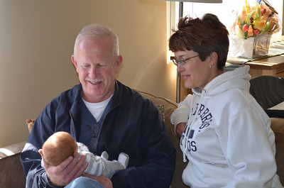 Grandpa and Grandma meet Oliver for the first time.