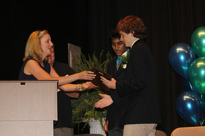 Caroline awarding Caleb and Dhruv Headmaster's Awards