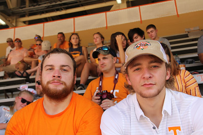 "Caleb & Wyatt at the game - it's funny, but all my pictures of the weekend seem to have an ""orange"" cast"