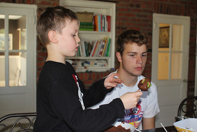 Caleb helped Aaron decorate the cake pops