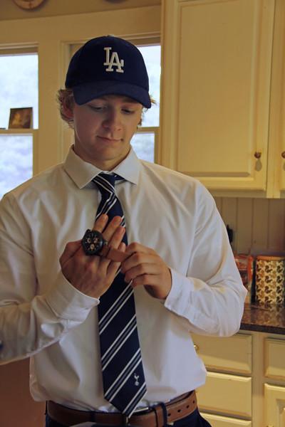 Wyatt putting on his new watch